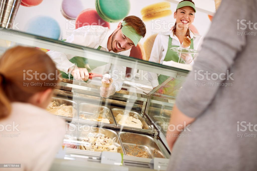 In pastry store sellers serves customers stock photo