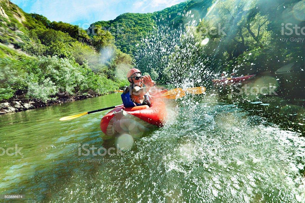 in river canoe splashes stock photo