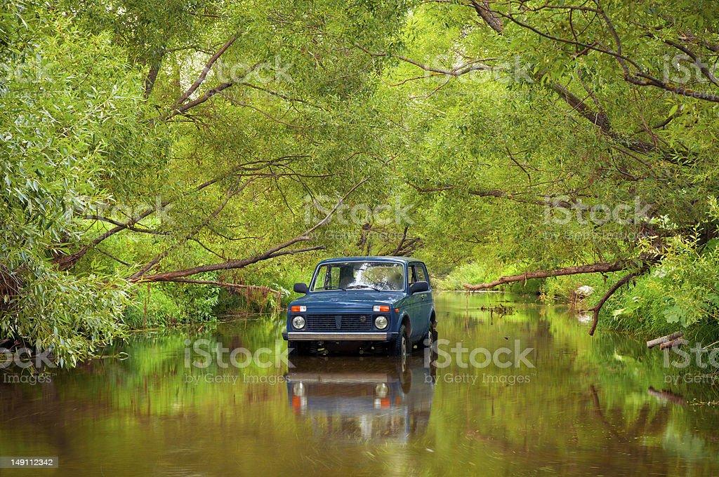 SUV in river stock photo