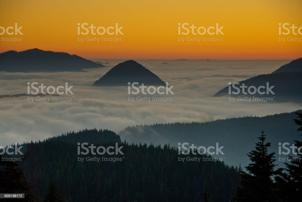 Peaks Above the Fog at Sunset stock photo