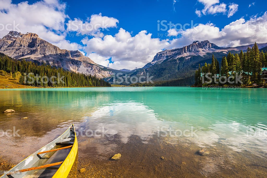 In shallow water the small boat is moored. stock photo