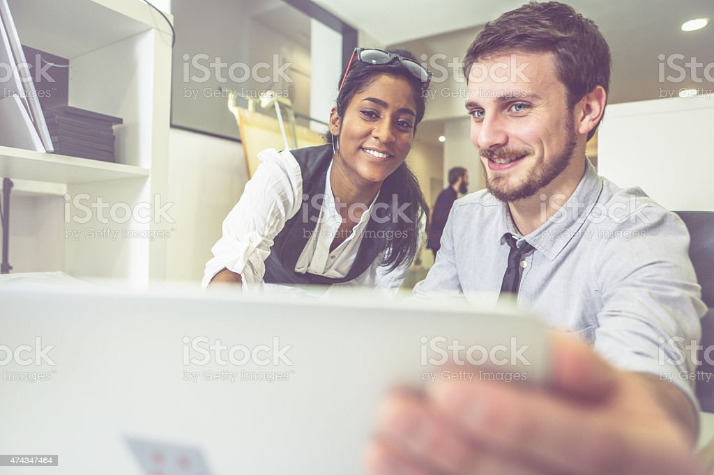 In the creative designers studio: reviewing a work stock photo