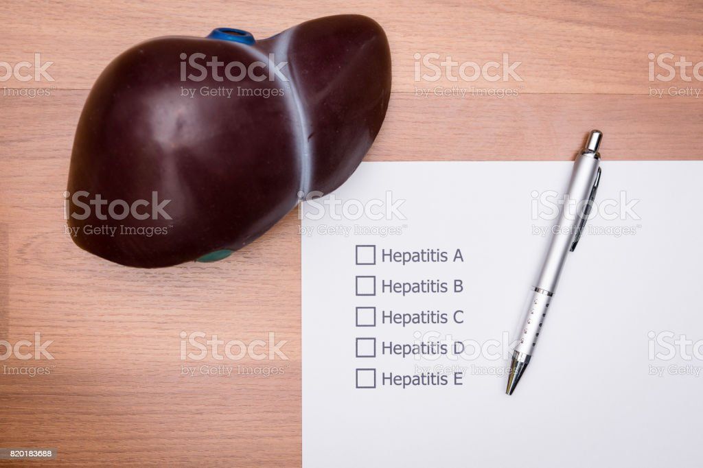 In the doctor's Office There is a form that the doctor made to diagnose the disease that occur in a patient's liver. Diagnosis form placed on the doctor's desk. stock photo