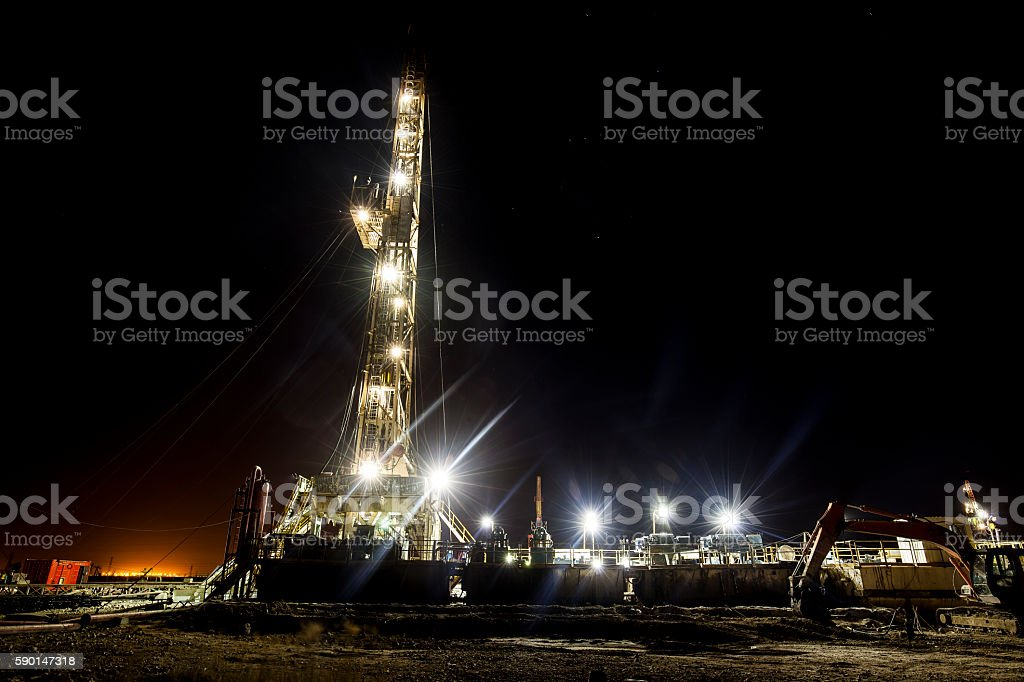 In the evening of oilfield derrick stock photo