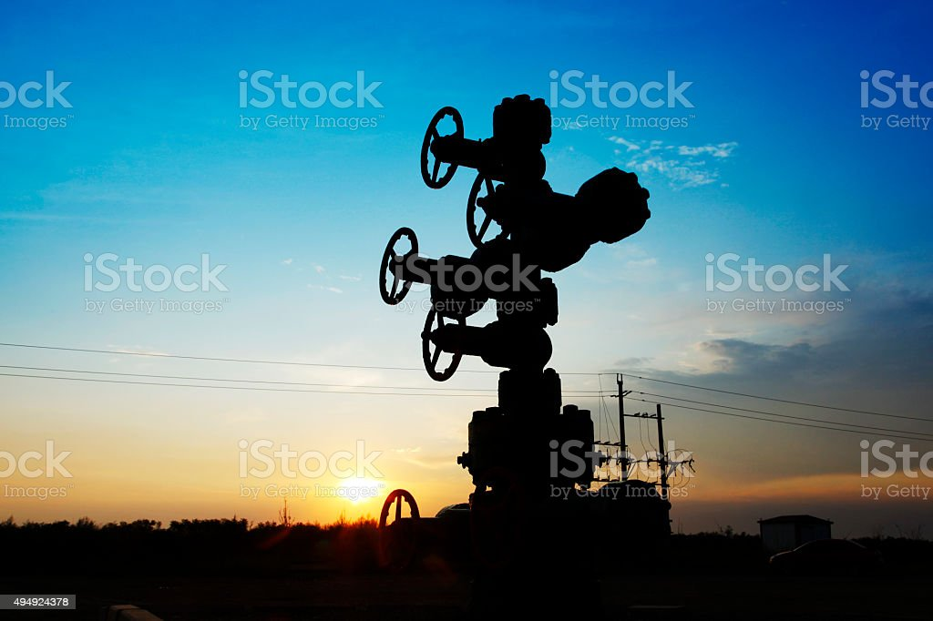 In the evening of oilfield pipeline silhouette stock photo