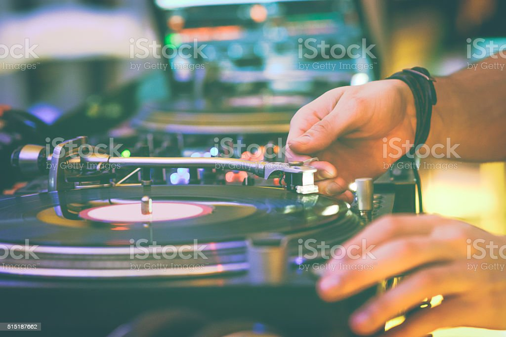 In the hands of the DJ stock photo
