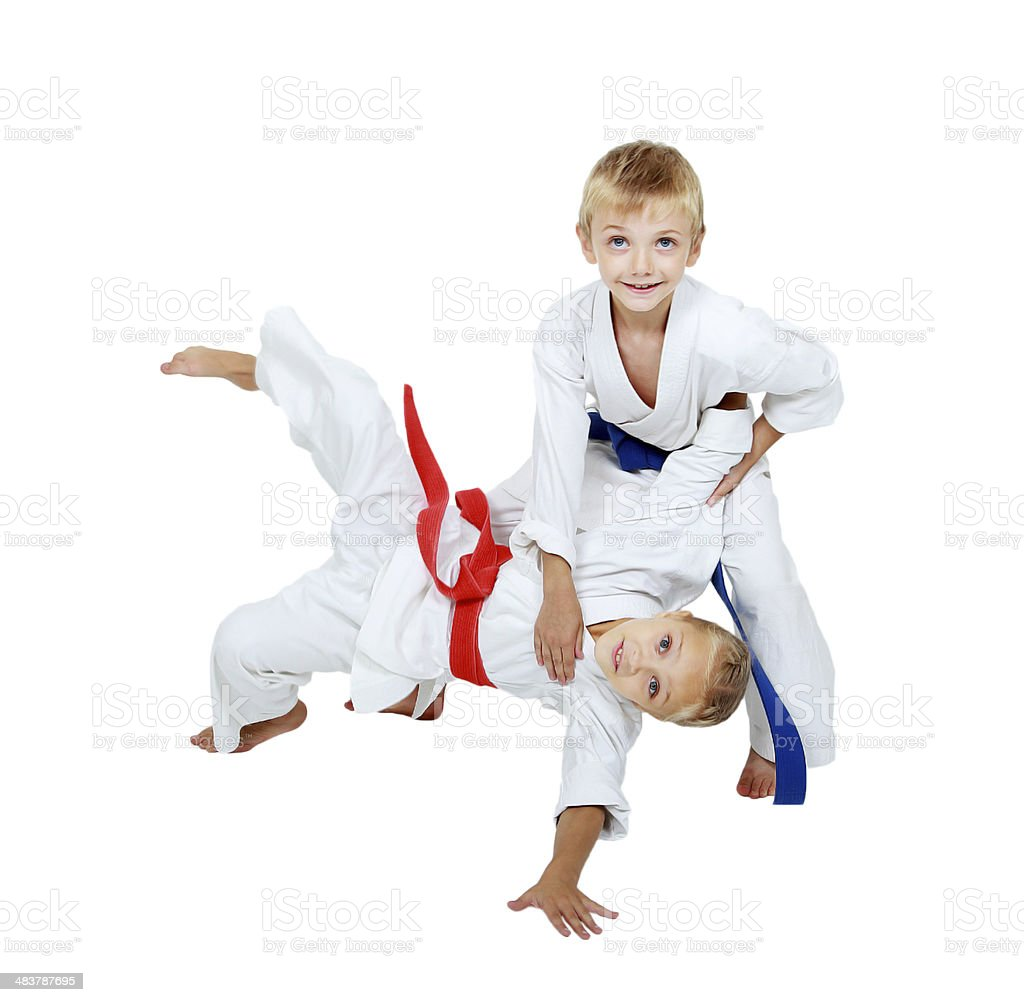 In the kimono boy throws a girl in a kimono stock photo