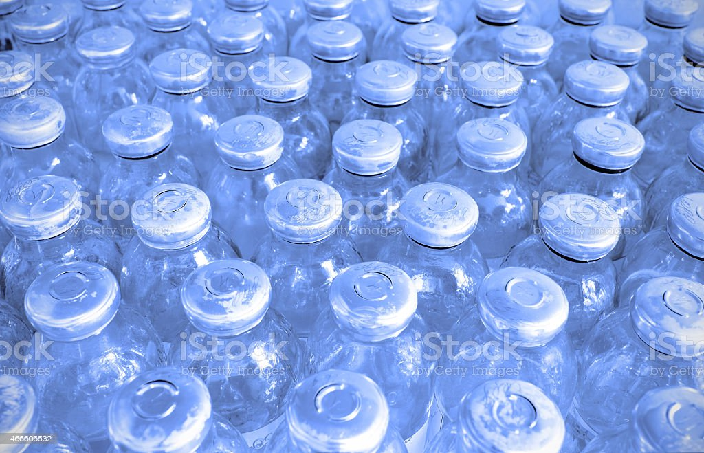 In the manufacturing room. set of glass bottles with medicine. stock photo