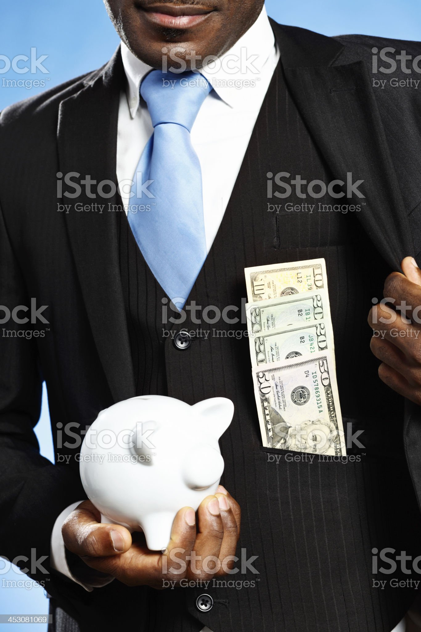 In the money! Businessman with piggybank and dollar stash royalty-free stock photo