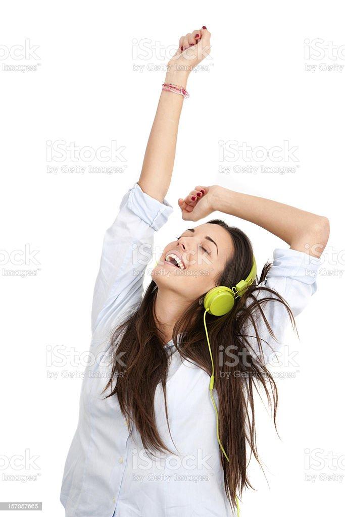 Dans le rythme avec des écouteurs. photo libre de droits
