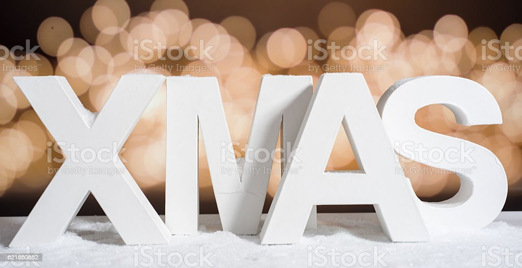 XMAS in white letter with blurred light background stock photo