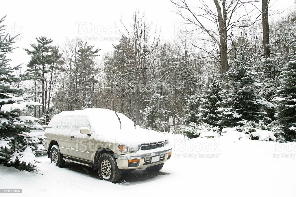SUV in winter landscape royalty-free stock photo