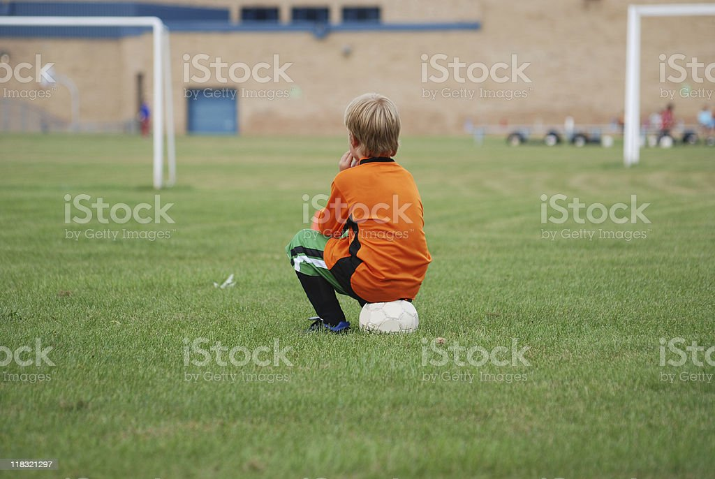inactive young soccer player waiting, enfant ballon incative royalty-free stock photo