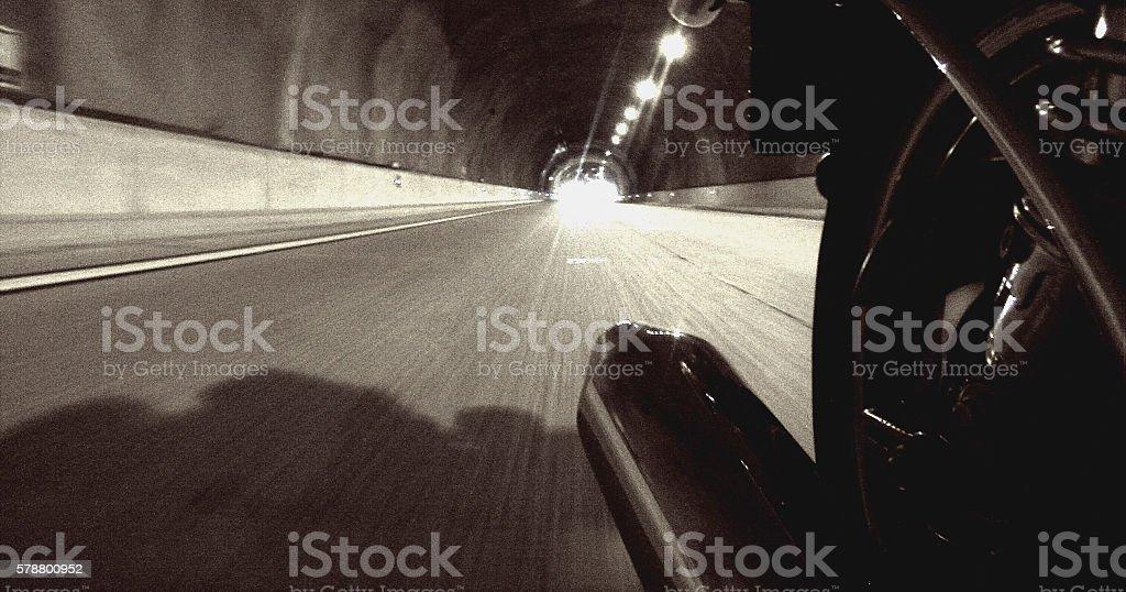 Inboard backwards motorbike on a tunne on a vintage effect stock photo
