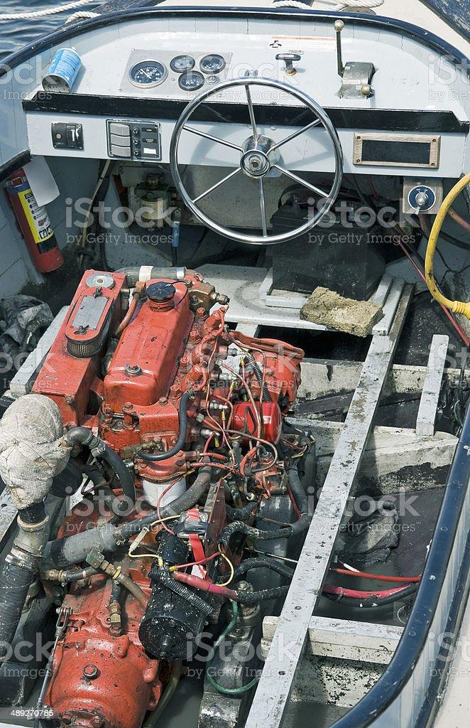 Inboard motor in old wooden boat stock photo