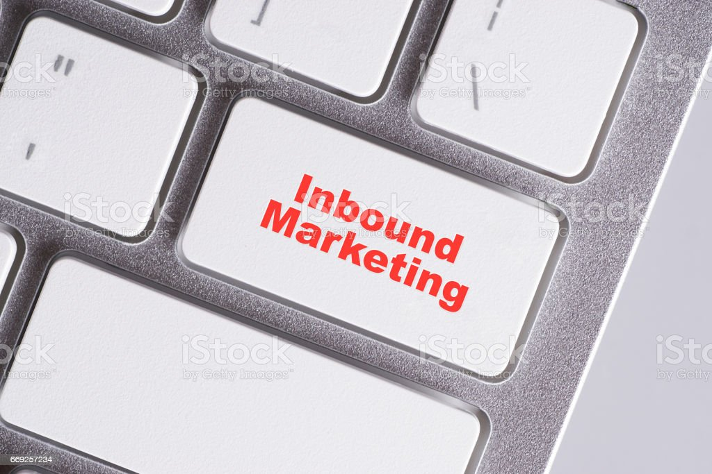 'Inbound Marketing' red words on white keyboard - online, education and business concept stock photo