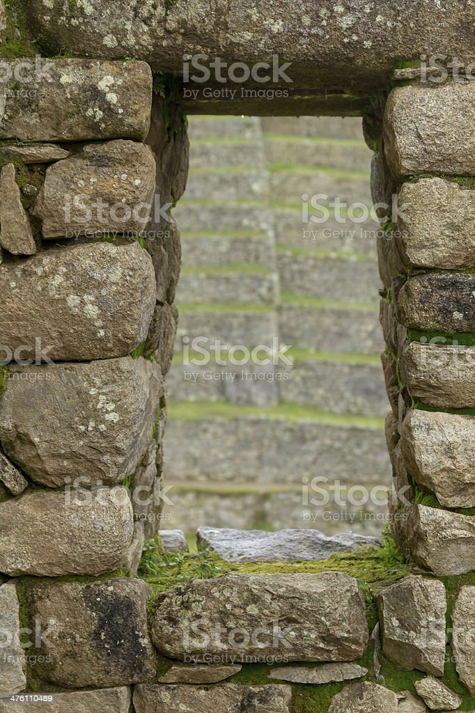 Inca window in a stone wall royalty-free stock photo