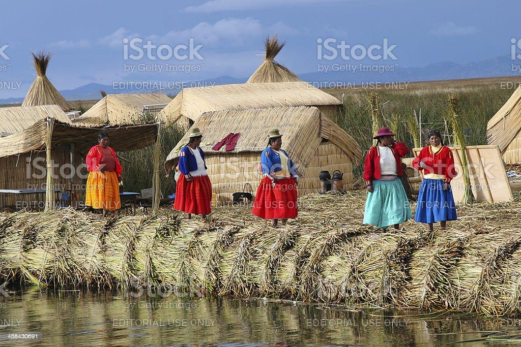 Inca Women on Floating Islands, Lake Titicaca, Peru stock photo