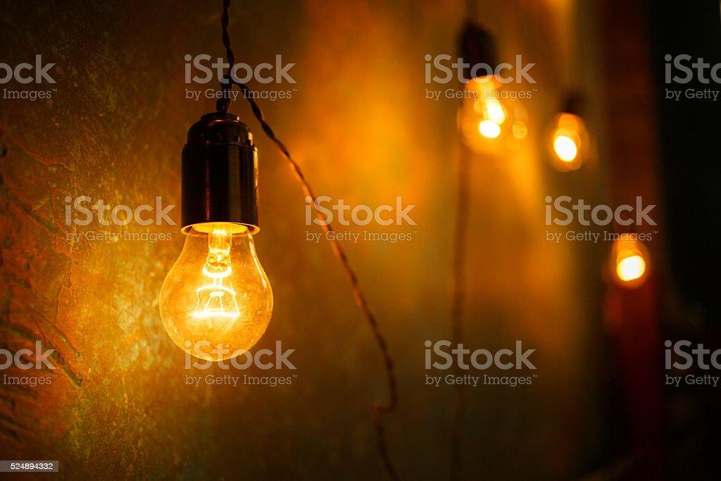 Incandescent lamps in a modern studio. Edison lamp. stock photo