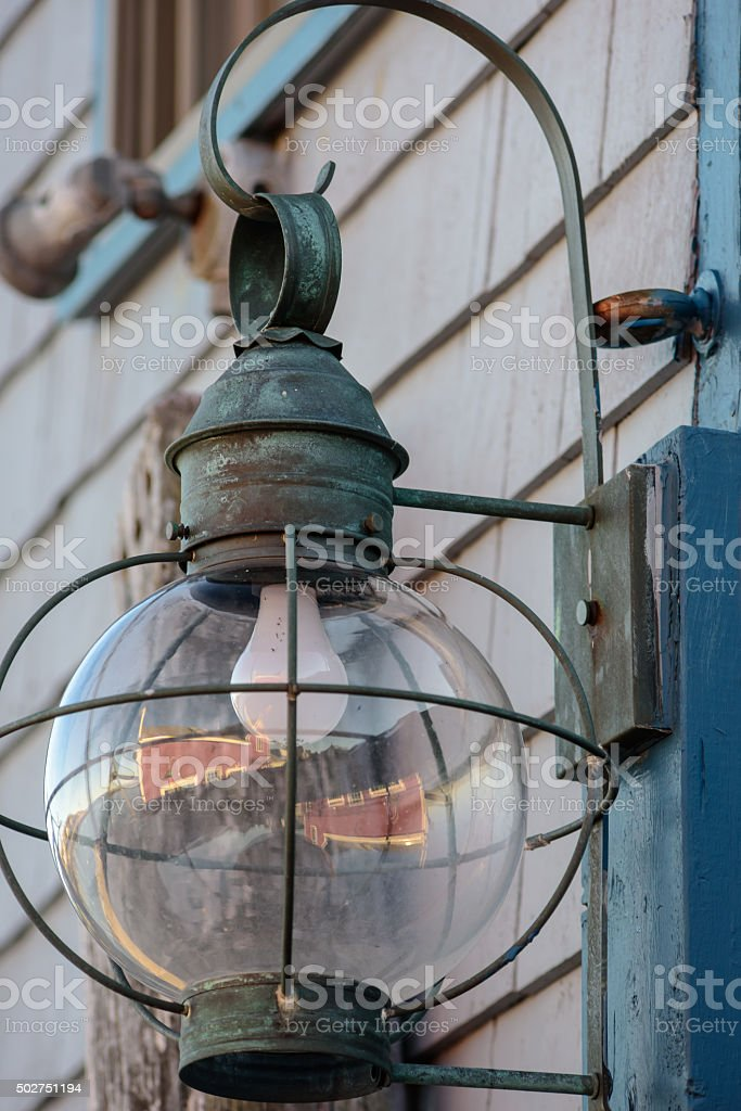 Incandescent light in Old Rockport Lantern stock photo