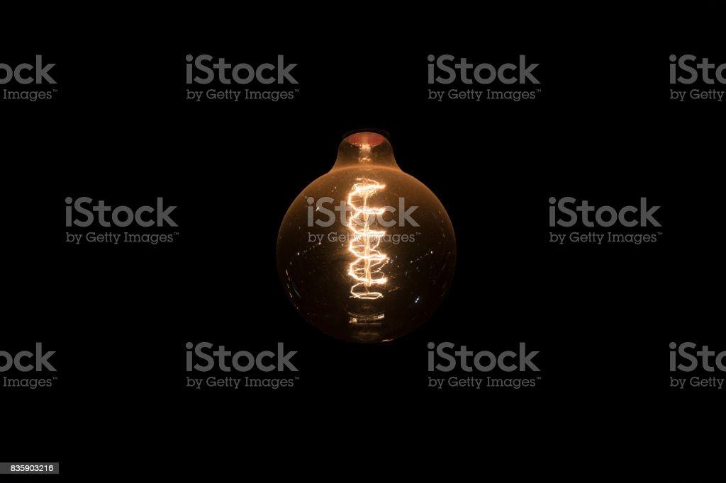 incandescent light on black background stock photo