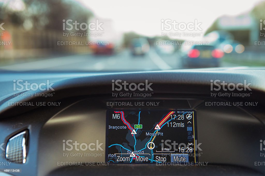 In-car Sateillite Navigation in use on the road. stock photo