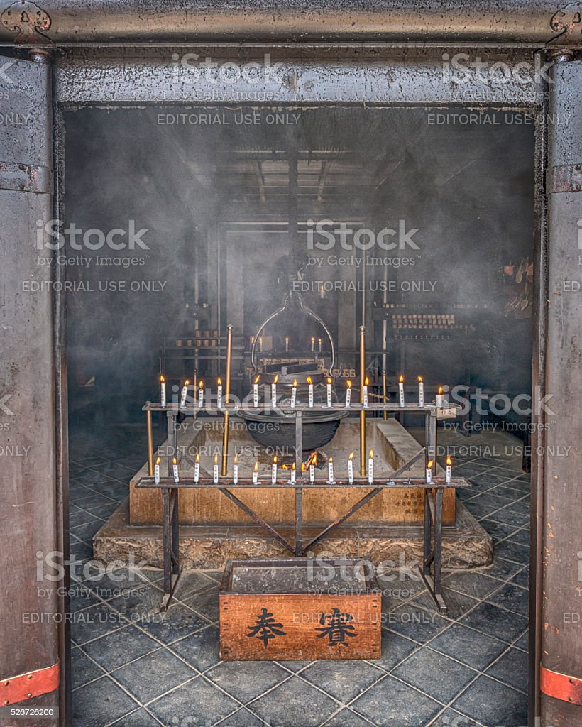 Incense and candles burn infront of the eternal flame stock photo