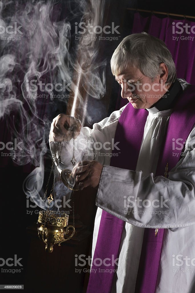 Incense burner and priest stock photo