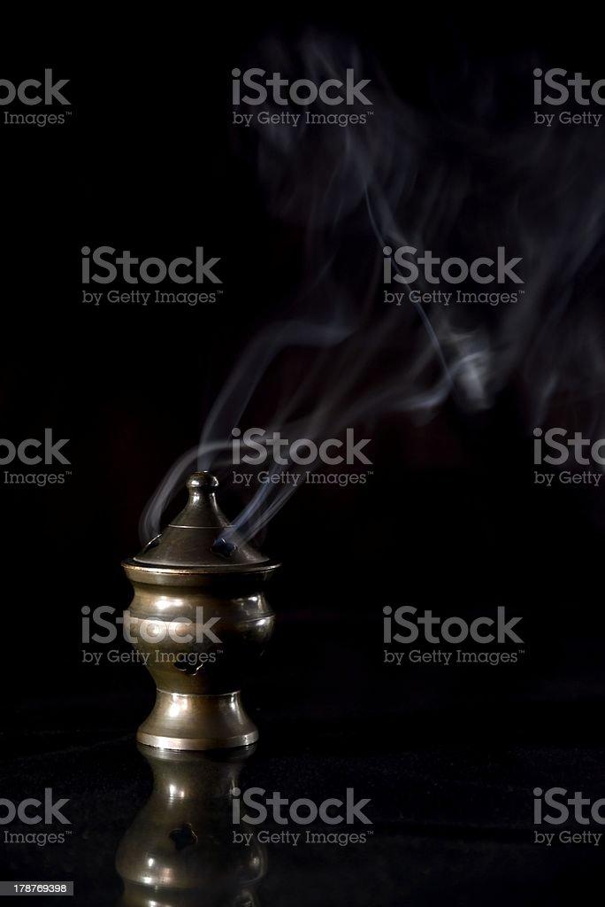 Incense Burner isolated on black, trailing smoke stock photo