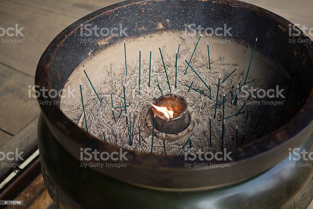Incense burning at temple royalty-free stock photo