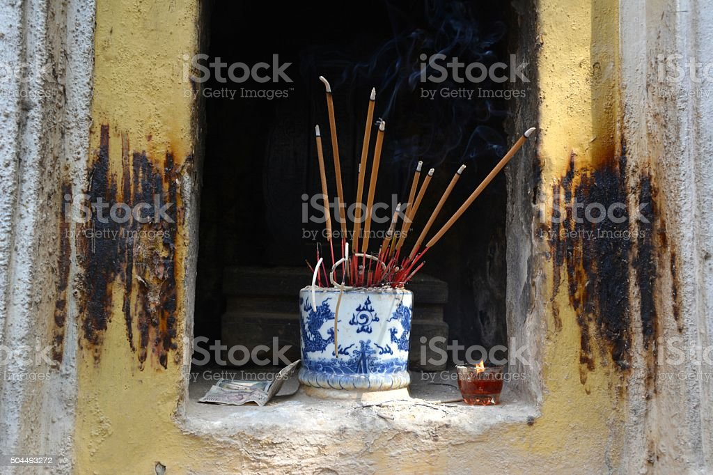 Incense burning on a niche at Tran Quoc Pagoda, Hanoi stock photo