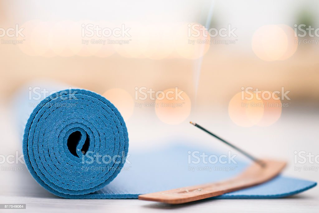 Incense Burns On A Yoga Mat stock photo