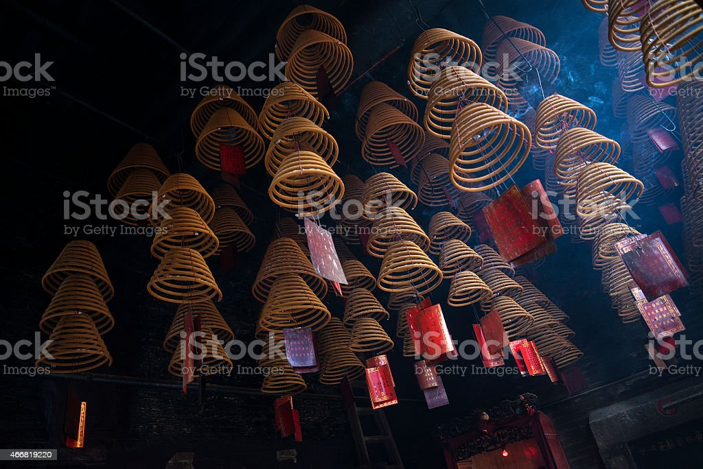 Incense coils burning in a temple stock photo