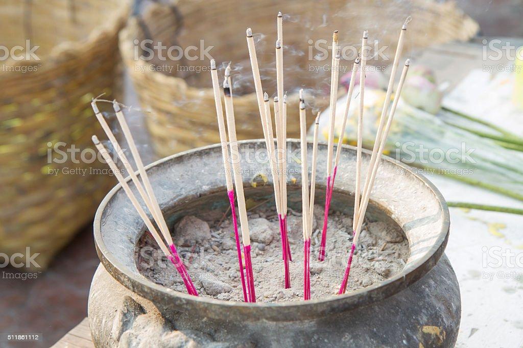 incense in pot stock photo