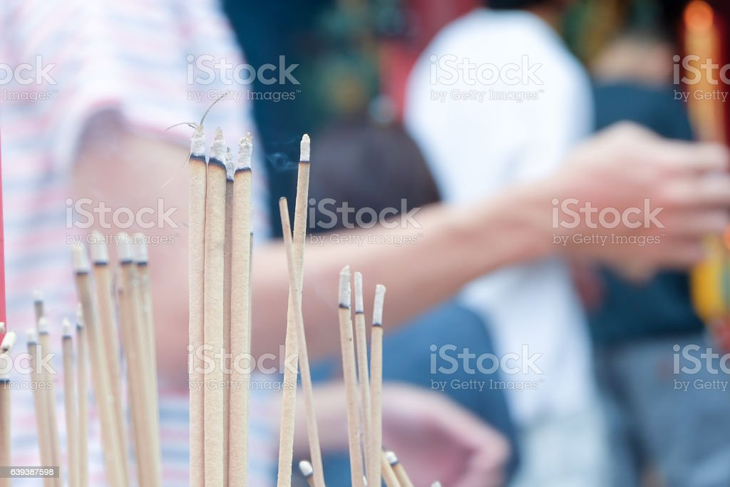incense stick burning with smoke. praying Chinese Buddhist temple stock photo