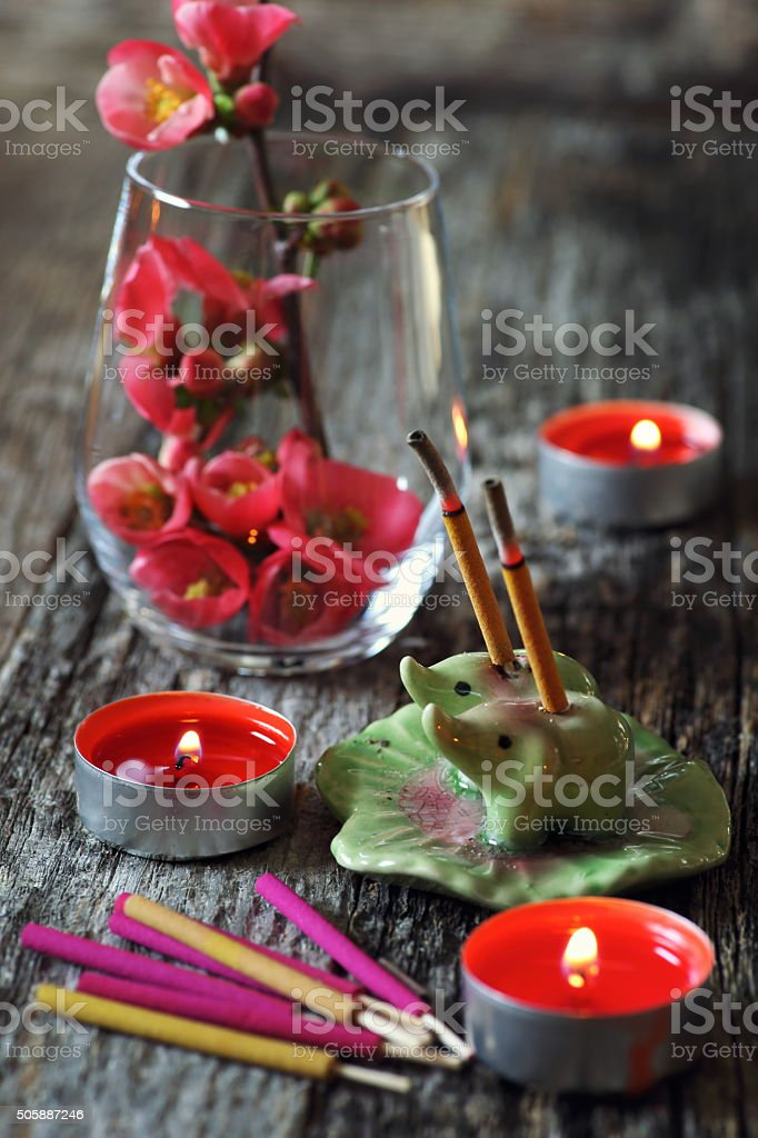Incense sticks and blossoming branch stock photo