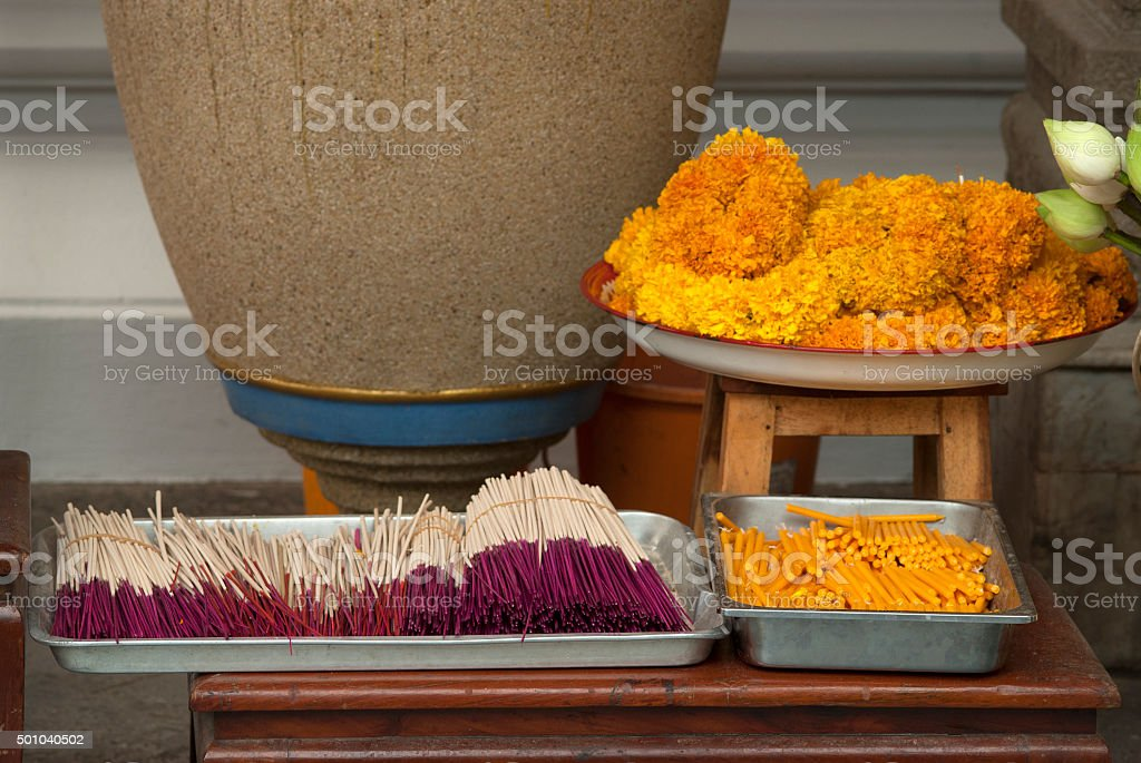 incense sticks and candles in Bangkok temple stock photo