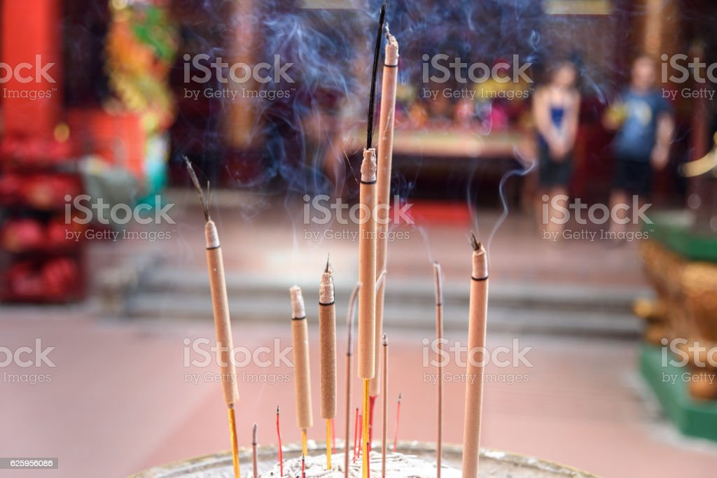 Incense sticks inside Chinese temple stock photo