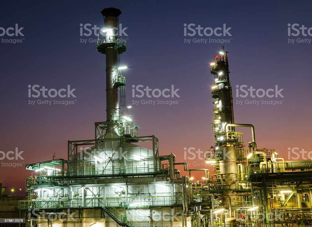 incinerator waste gas in petrochemical plant at twilight time stock photo