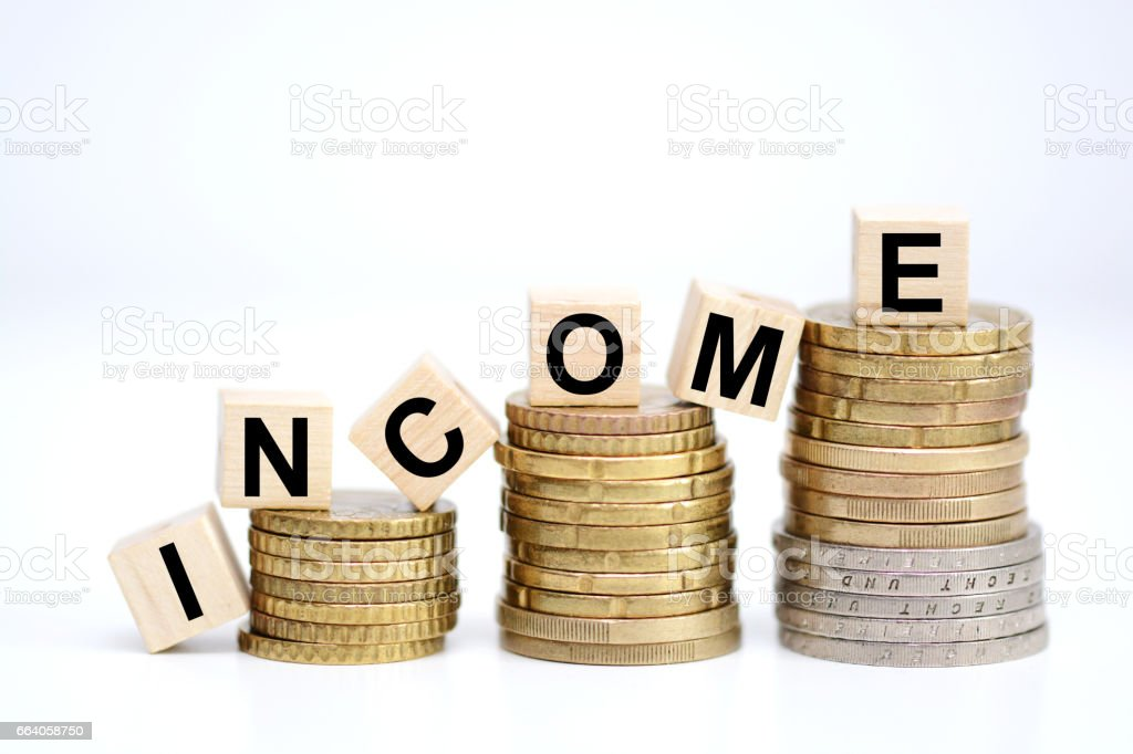 Income increase concept with upward pile of coins stock photo