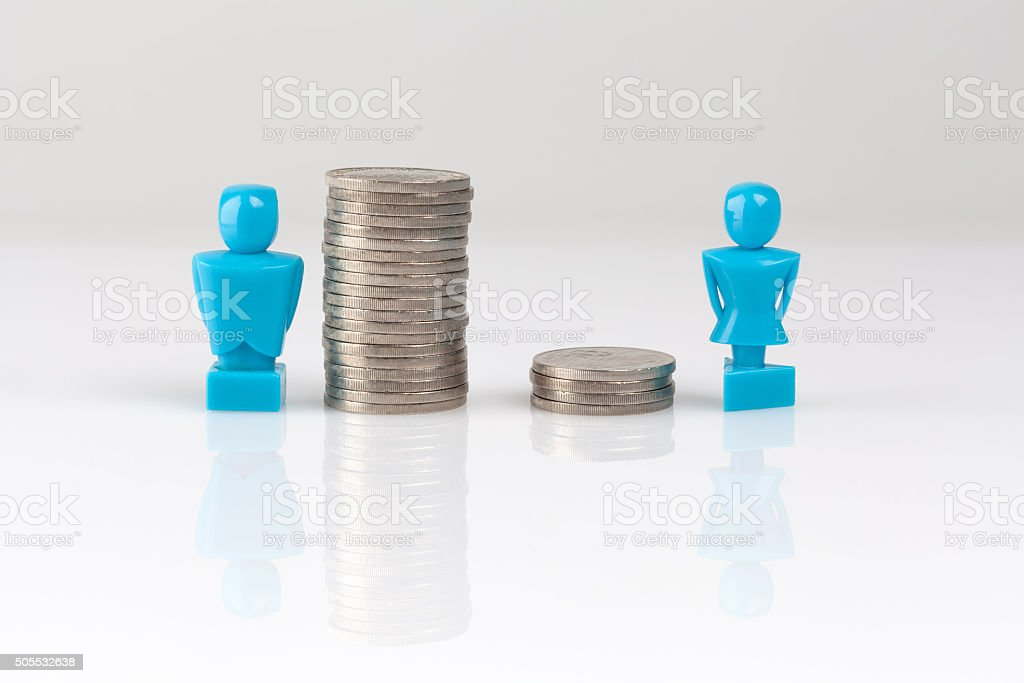Income inequality concept with figurines and coins stock photo