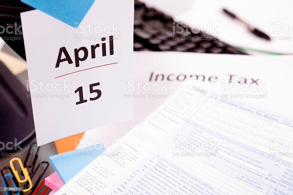 USA income tax deadline is April 15. 1040 form. Desk. stock photo