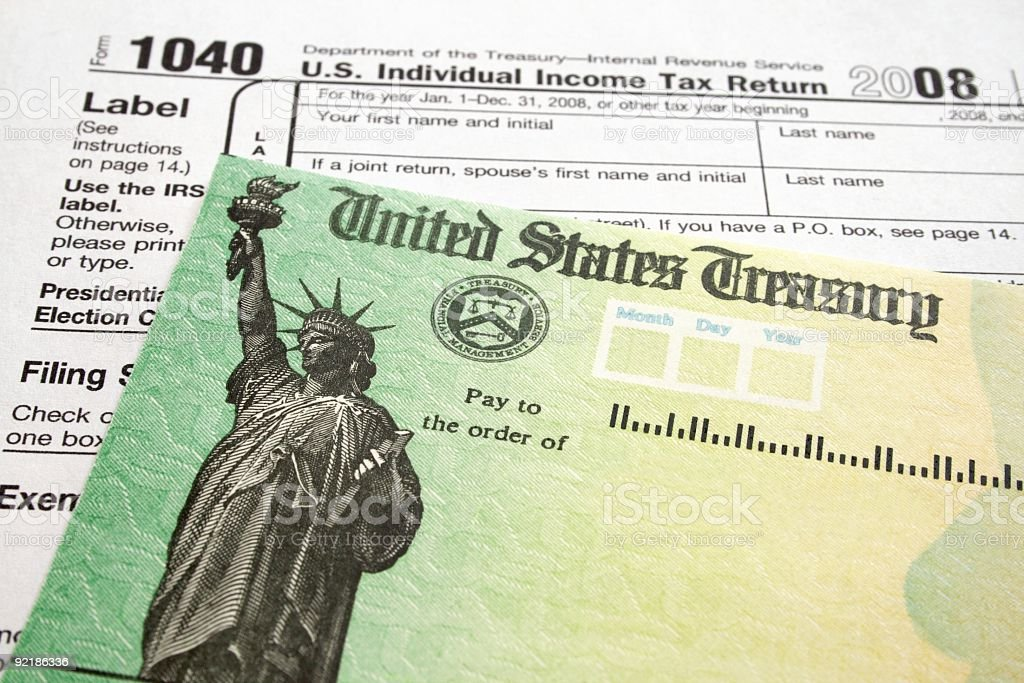 Income Tax Form and Refund Check stock photo
