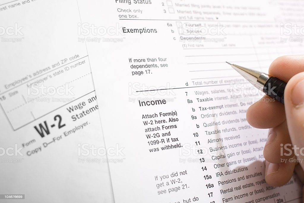 U.S. Income Tax Forms - Filling Out W-2 and 1040 stock photo