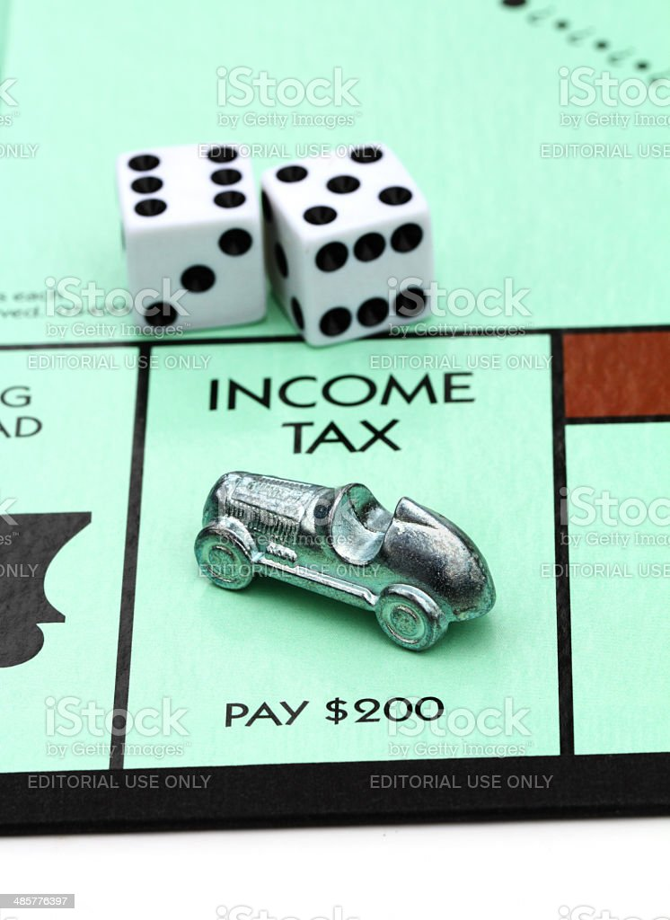 Income Tax on Monopoly game board royalty-free stock photo