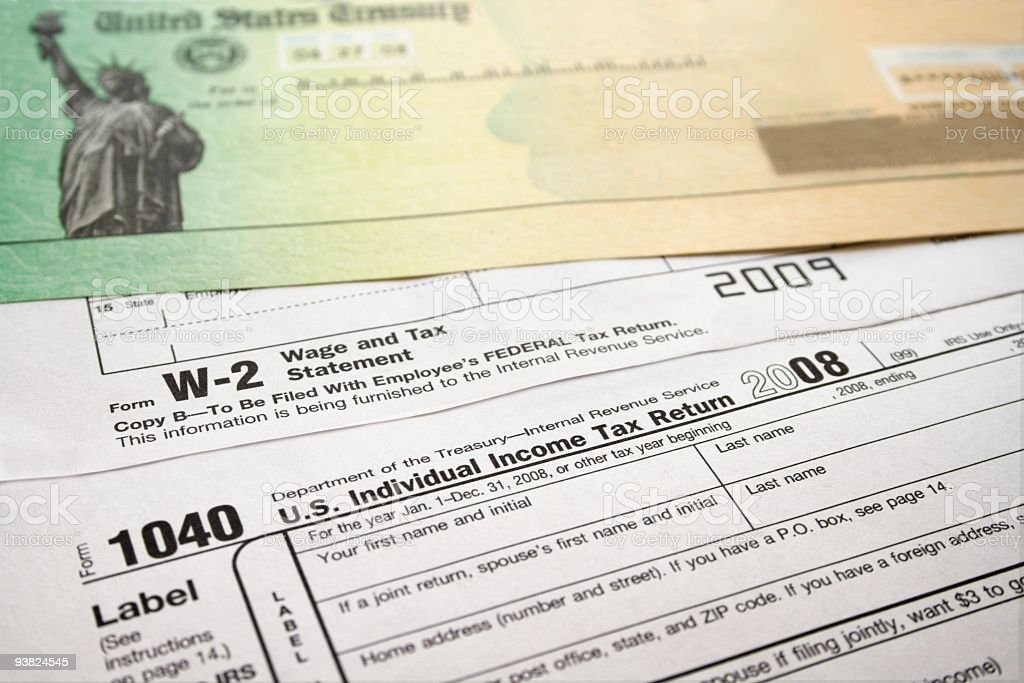 Income Tax Refund Check and Forms stock photo