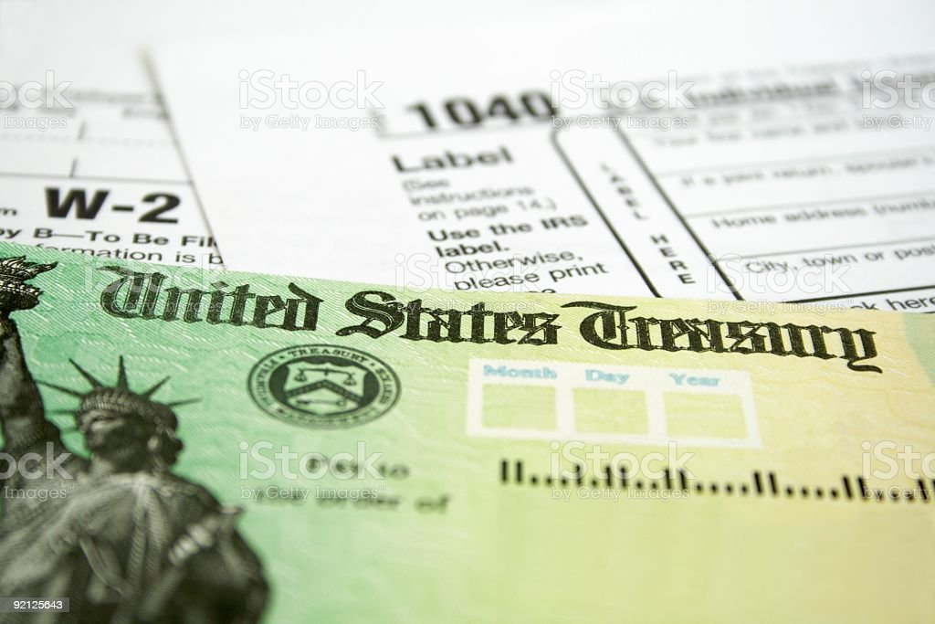 Income tax refund check on tax forms stock photo