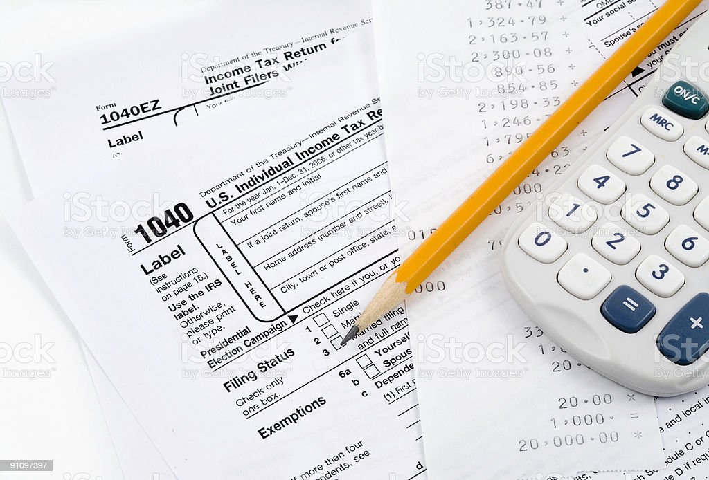 Income Tax Return with Calculator royalty-free stock photo