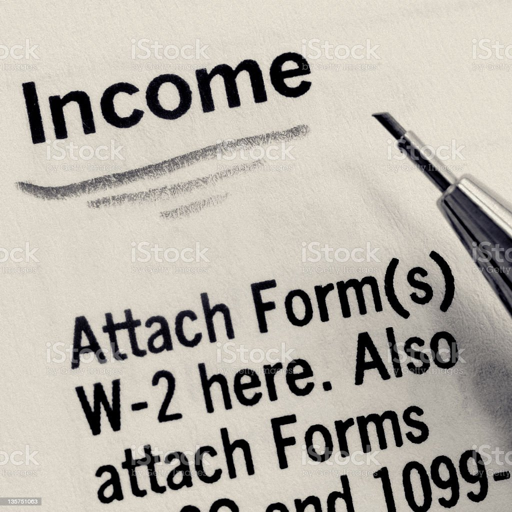 Income Underlined on U.S. Tax Form stock photo