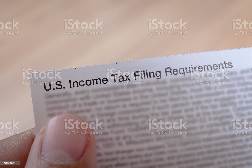 US incoming tax and hand for business concept background stock photo